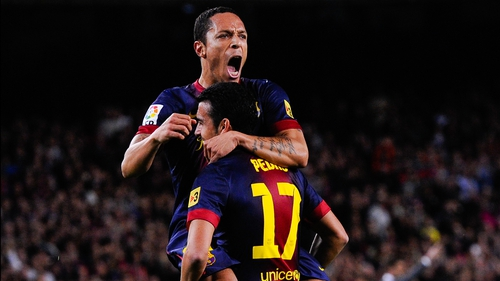 Adriano Correia of Barcelona celebrates with team-mate Pedro Rodriguez of  after scoring his side's opening goal