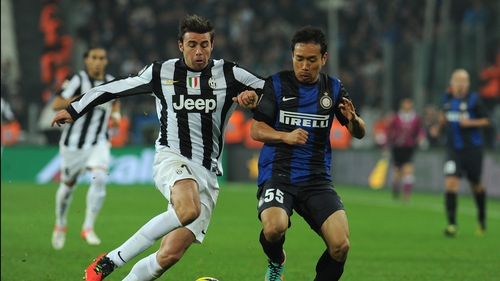 Andrea Barzagli (l) of Juventus competes with Yuto Nagatomo of Inter Milan