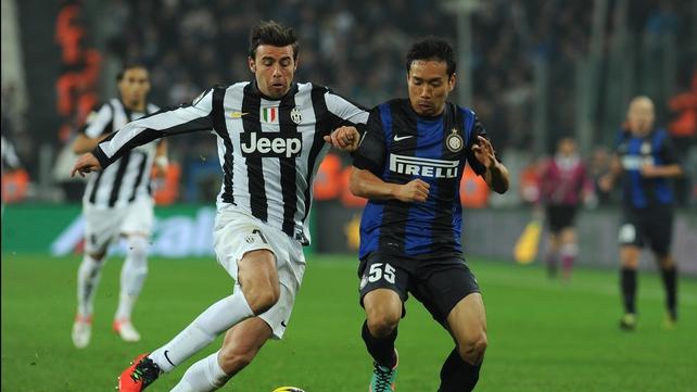Andrea Barzagli (l) of Juventus competes with Yuto Nagatomo of Inter Milan