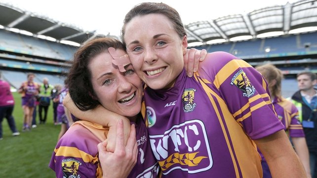 Claire O'Connor and Catherine O'Loughlin celebrate Wexford's third All-Ireland in a row