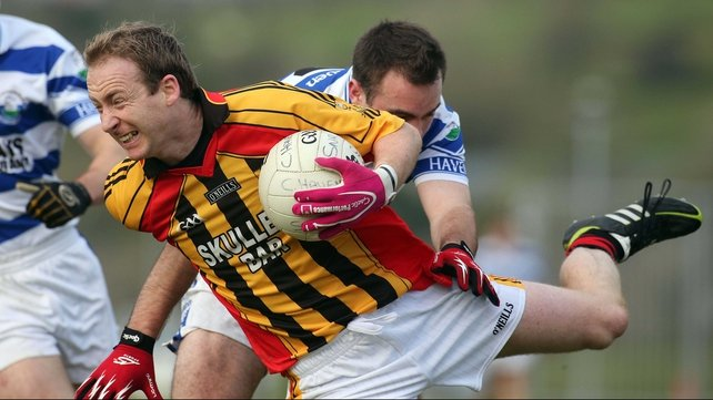 Michael Reidy of Dromcollogher- Broadford attempts to avoid Castlehaven's Mark Cahalane