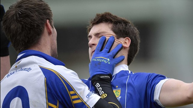 Gareth McKinless of Ballinderry gets to grips with Ciaran McGinley of Errigal Ciaran