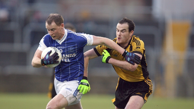 Anthony Thompson of Naomh Conaill is chased by Mark McGowan of St Eunan's