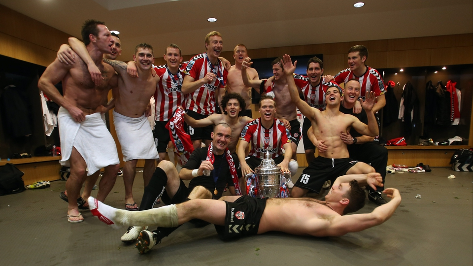 Derry players celebrate in the dressing room