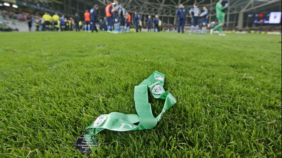 A runners-up medal lying in the grass after being thrown away by a St Patrick's Athletic player