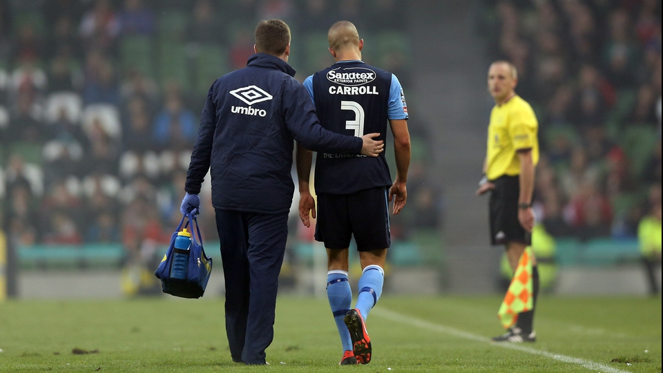 Jake Carroll of Pat's was forced to leave the pitch with an injury