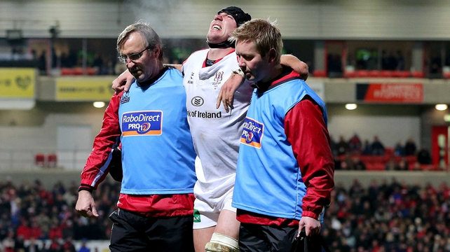 Ferris is helped off the pitch after picking up the injury against Edinburgh