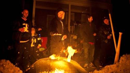 Residents keep warm as fuel and electricity supplies remain low and temperatures drop