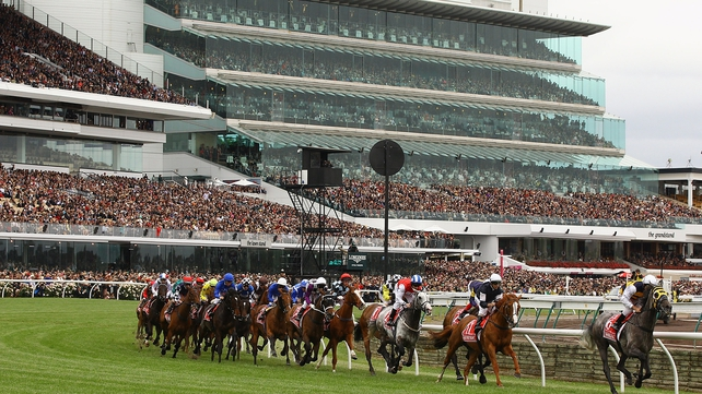 The field rounds the bend in last year's Melbourne Cup at Flemington Racecourse