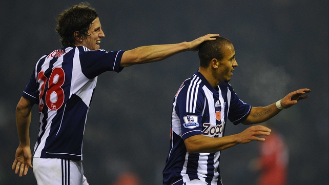 Billy Jones (L) and Peter Odemwingie celebrate WBA's opener