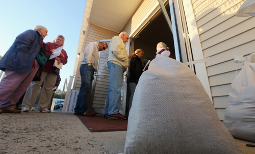 Voters in an area of New Jersey affected by Hurricane Sandy line up to vote