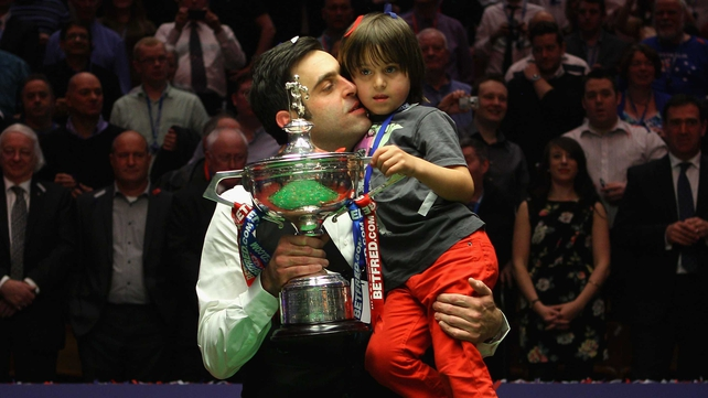 Ronnie O'Sullivan celebrates the World Championship with his son last May