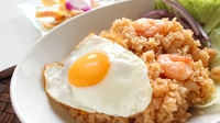 Nasi Goreng  - Serve each plateful topped with a fried egg, a sprinkle of sliced spring onions and chilli, and some prawn crackers if you want.