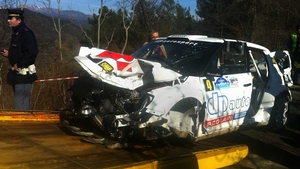 The wreckage of Robert Kubica's Skoda Fabia is loaded onto a tow truck in Andora