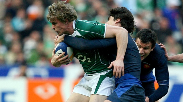 Andrew Trimble gets tackled by David Skrela, much to the confusion of JP Pietersen