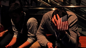 Disappointed Romney supporters wait for their candidate's concession speech in Boston