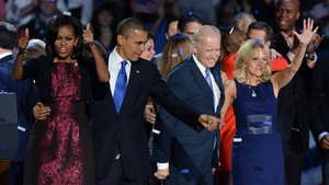President Obama and Vice-President Joe Biden along with their wives and families take to the stage in Chicago