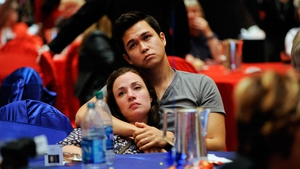 Supporters of  Mitt Romney  - Heidi Bischoff (L) and Paul Cimolini react after hearing that President Barack Obama has been re-elected