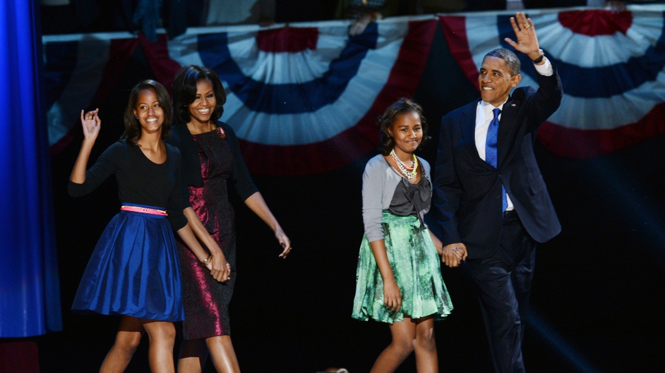 President Obama, wife Michelle and daughters Malia and Sasha walk onto the stage in Chicago