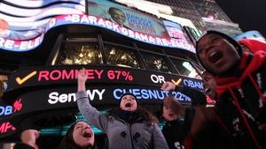 People celebrate in Times Square as it is announced that President Obama has been re-elected
