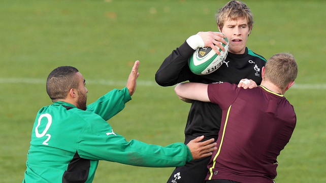 Andrew Trimble is tackled by Simon Zebo and Keith Earls in training