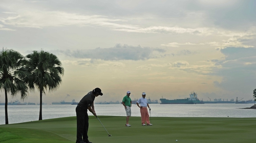 Rory McIlroy putts during the pro-am prior to the start of the Barclays Singapore Open at the Sentosa Golf Club