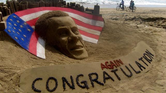 A sand sculpture on Puri beach in India congratulates the US president