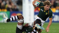 RTÉ's Michael Corcoran talks to South Africa out-half Patrick Lambie
