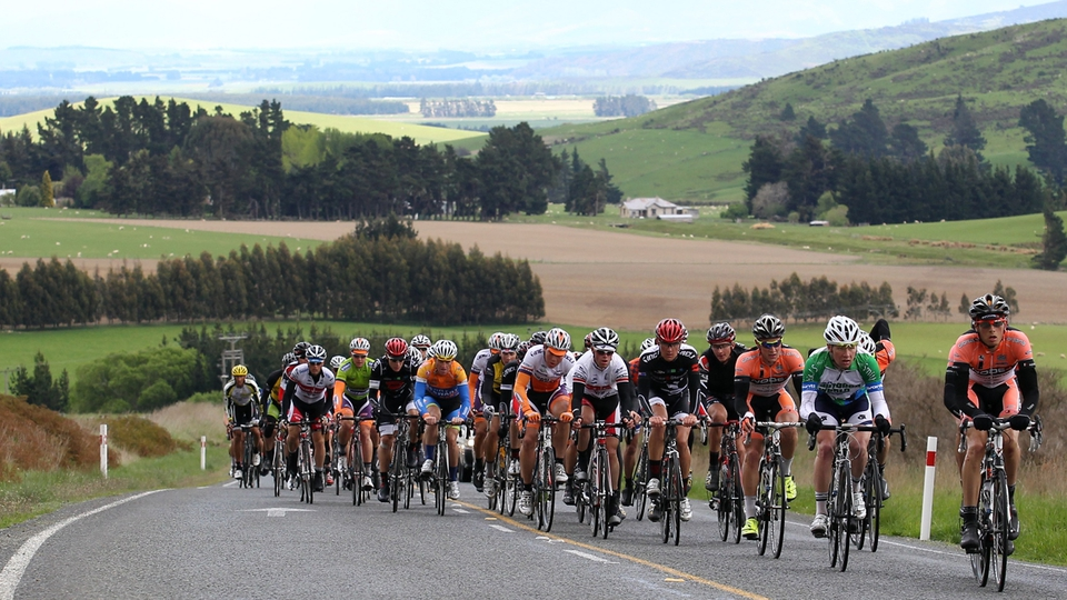 The main peloton complete a climb during stage five of the 2012 Tour of Southland