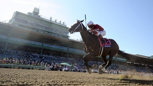 Corey Nakatani rides Tapizar to a win during the Breeders' Cup Dirt Mile at Santa Anita Park