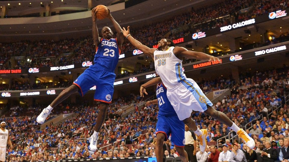 Jason Richardson of the Philadelphia 76ers grabs a rebound away from Kenneth Faried of the Denver Nuggets at the Wells Fargo Center