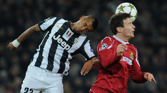 Ivan Runje of Nordsjaelland (right) with Arturo Vidal of Juventus (left).