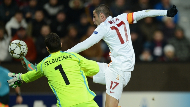 Galatasaray's striker Burak Yilmaz (right) and Cluj's Portuguese goalkeeper Mario Felgueiras vie for the ball