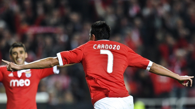 Oscar Cardozo's second-half double against Spartak Moscow was enough to provide Benfica with their first group stage win