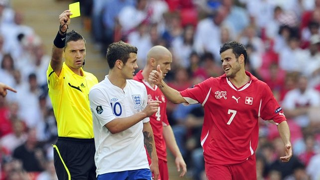Wilshere receives a yellow during his last international appearance for England