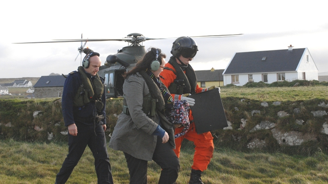 Sergeant Shane Guinan carries the ballot box to the polling station on Tory Island accompanied by Returning Officer Claire Sharkey and Garda Fran Coyle (Pic: Defence Forces)