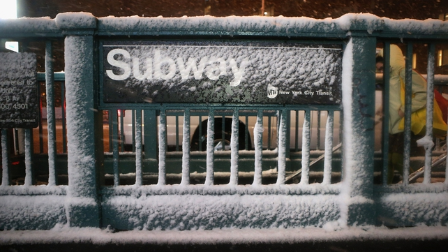 A subway stop stands snow-covered at Union Square after New York City was hit by a storm