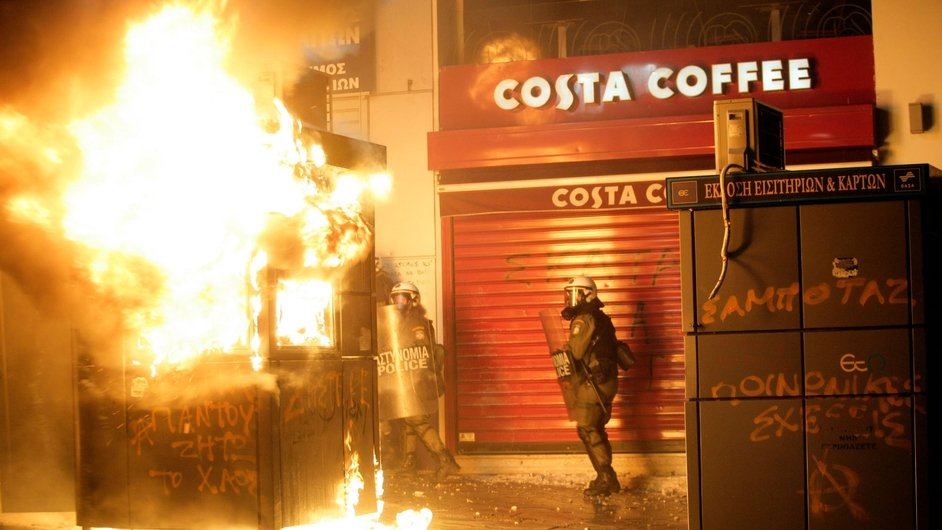 A kiosk is set on fire during a protest rally in Athens