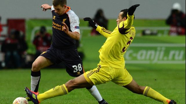 Joao Carlos tackles Liverpool's Adam Morgan