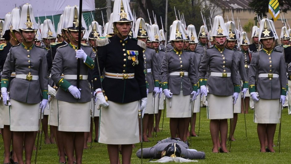 A sub-lieutenant lies on a field after fainting during a ceremony at the police school in Bogota in Colombia