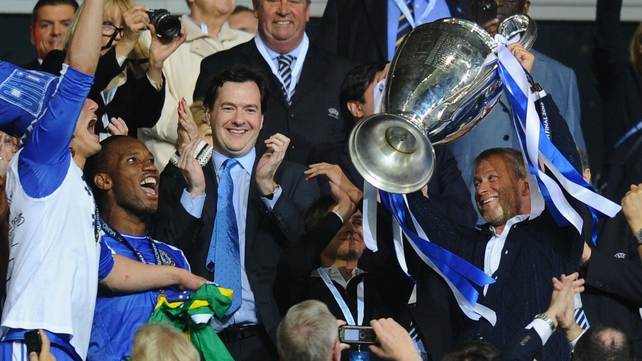 Roman Abramovich (r) sees his club make a profit for the first time since he took over in 2003