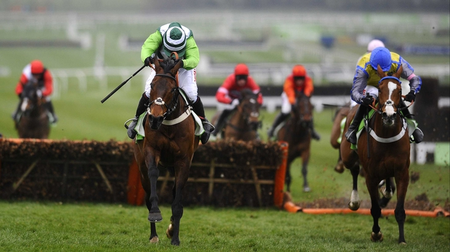 Overturn (r), seen here finishing second to Rock On Ruby in this year's Champion Hurdle at Cheltenham, impressed on his chasing debut