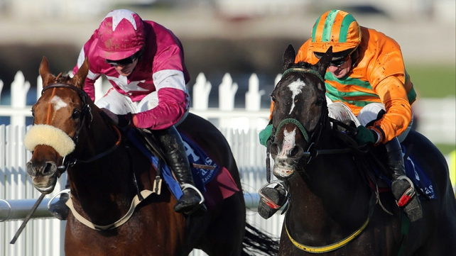 The well-backed Texas Jack (r) and Paul Carberry beat Make A Track and Davy Russell a touch cosily in the beginners' chase