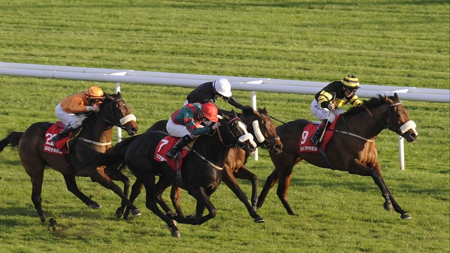 Art Scholar and Franny Norton forge ahead of Communicator (nearside) and Voodoo Prince (white cap) to win the November Handicap