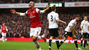 Lukas Podolski scored after 23 minutes to put Arsenal 2-0 up