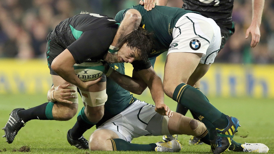 Mike McCarthy, who was awarded man of the man, is held by two South African tacklers