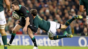 Ulster's Ruan Pienaar gets to grips with Ireland's out-half Jonathan Sexton