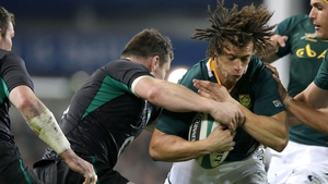 South Africa full-back Zane Kirchner is stopped by Cian Healy