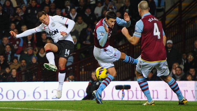 Javier Hernandez cannons the ball off Vlaar, helping the defender score an own goal