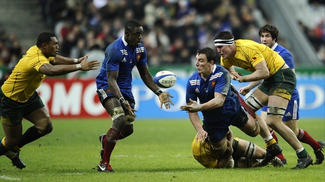 France's Louis Picamoles passes the ball to flanker Yannick Nyanga